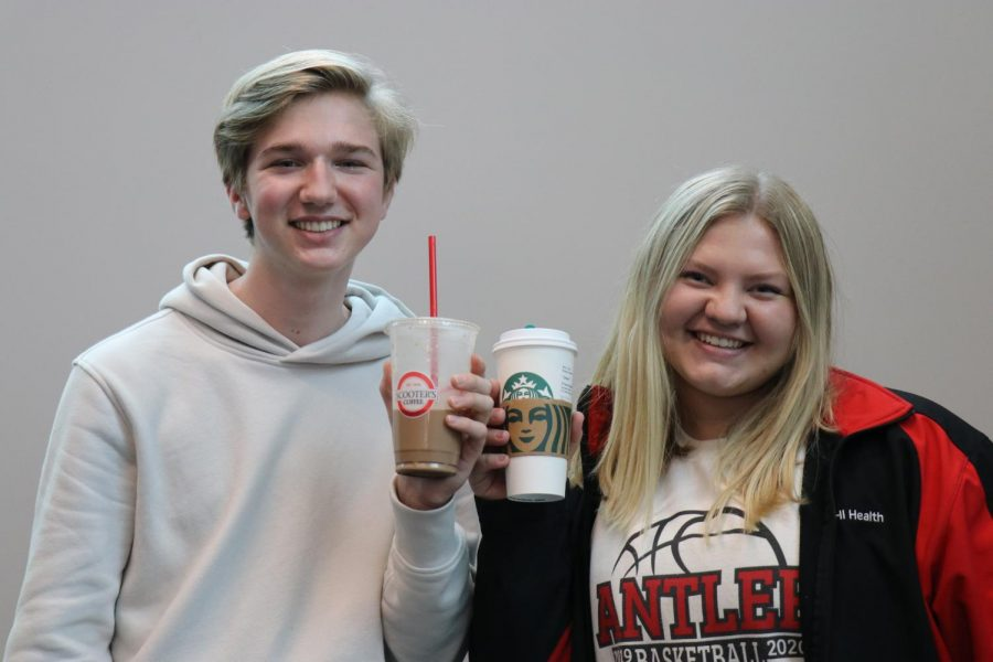 Wells Johnson and Grace Tanner with their coffee orders.