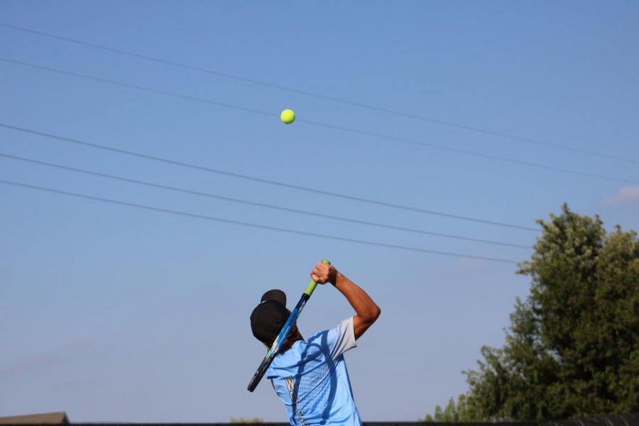 Nick Trofholz hitting his serve.