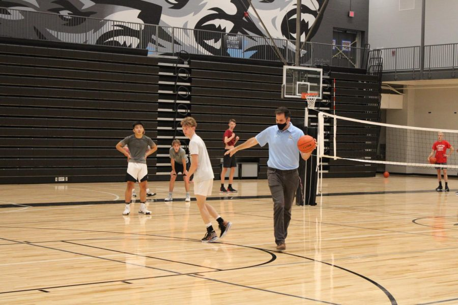 Coach King demonstrating a play at practice.