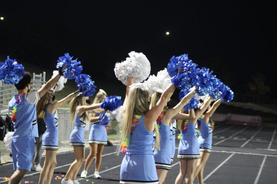 Elkhorn North cheerleaders raising their poms for kick-off.