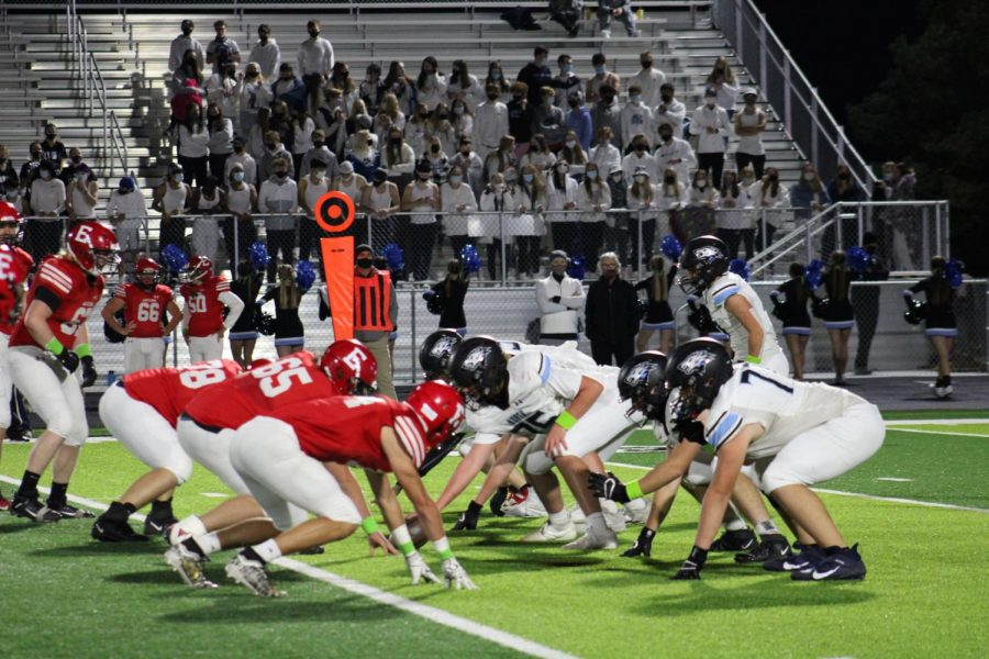 The+Elkhorn+North+offense+and+Elkhorn+defense+line+up+for+the+coming+play.
