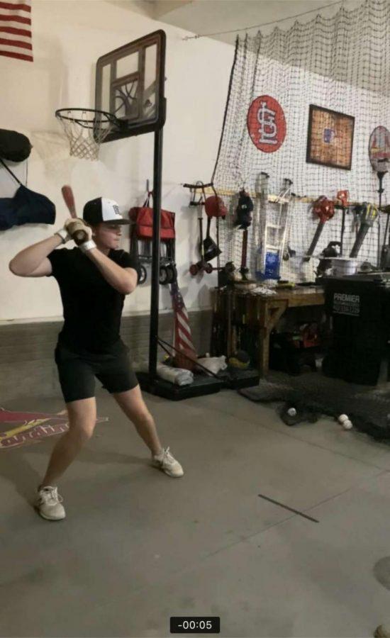 Drew Broady working on his swing.