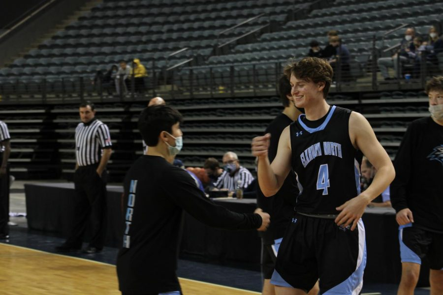 Ryan Harrahill and Imron Ergashev doing a pregame handshake.