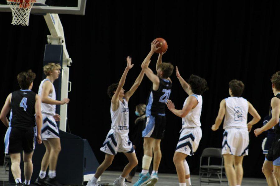 Nathan Cunningham taking a jump shot.