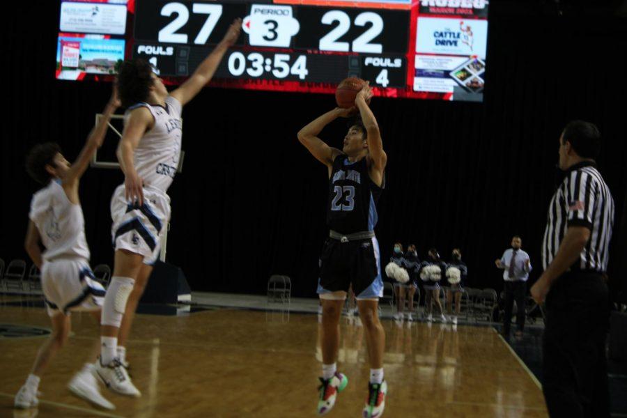 Brandon Orgilbold shooting a three-pointer.
