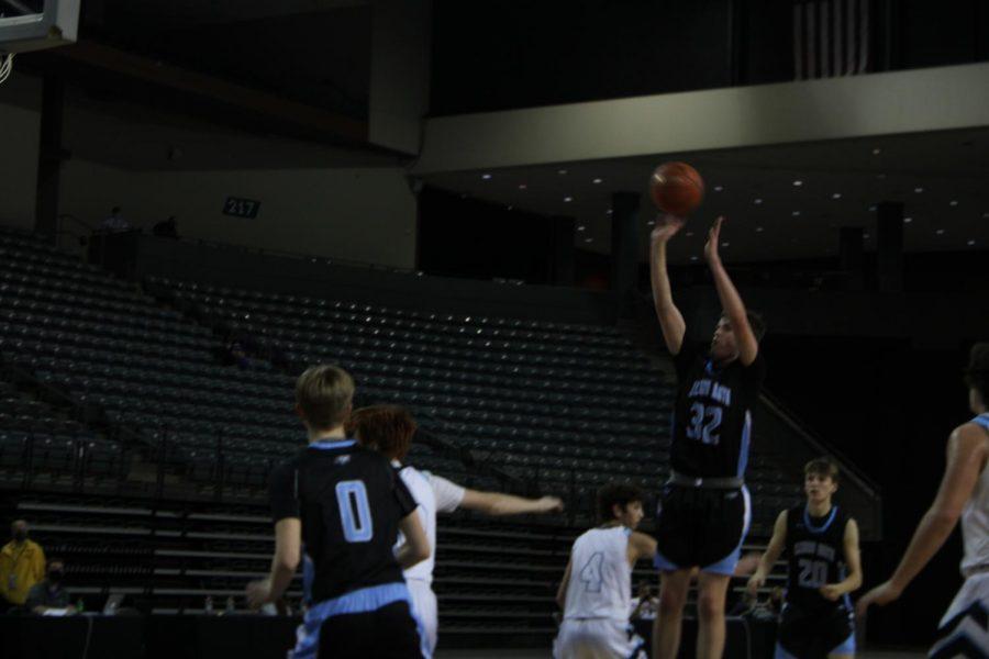Jack Lusk shooting a jump shot.