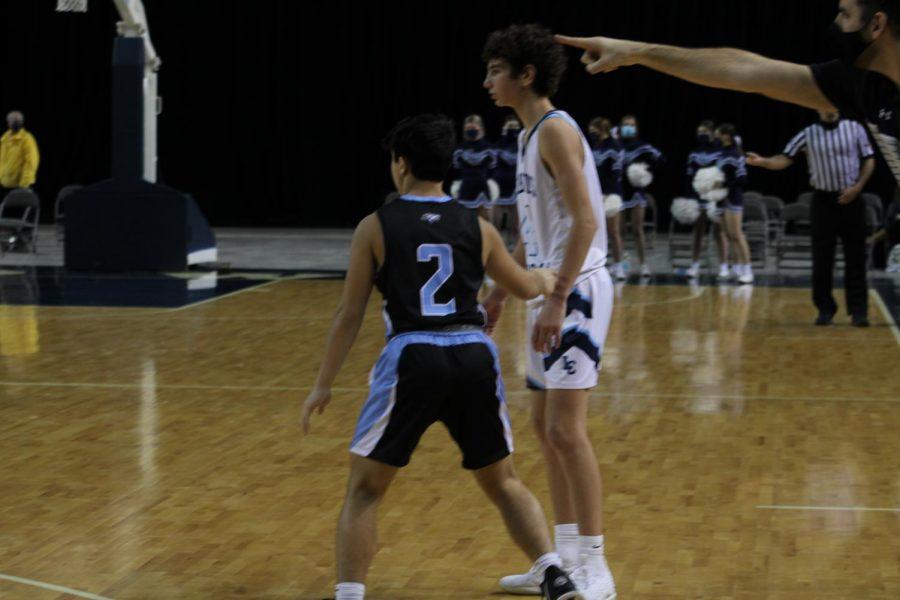 Imron Ergashev playing defense.