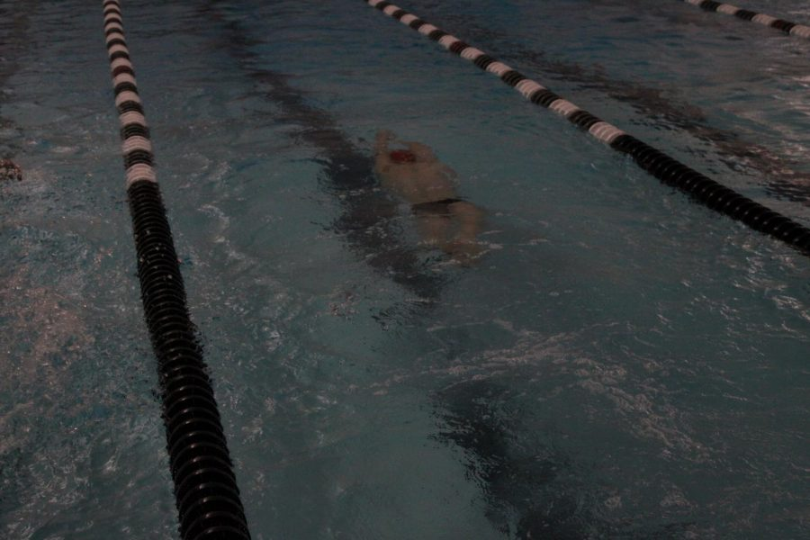 Jacob Horner, sophomore, coming out of a flip turn.