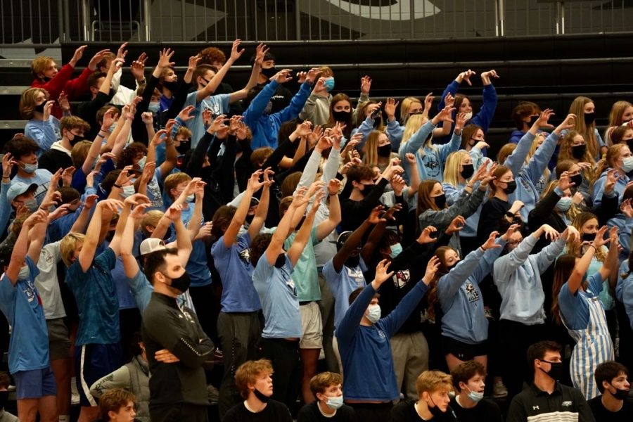 The Elkhorn North student section on its feet as it cheers on the Wolves