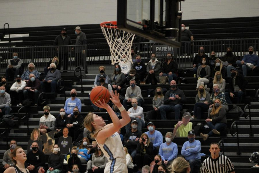 Reese Booth shooting a layup.