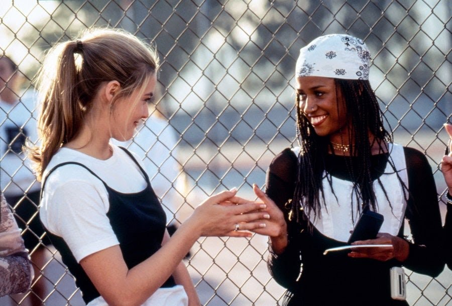 Cher from Clueless layers a baby tee and tank top in the movie.