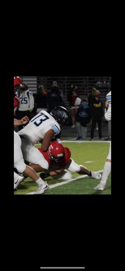 Shan Acharya pancakes an Elkhorn defensive lineman