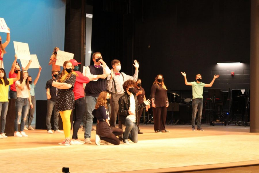 The leads of the musical all together at the end of the scene.