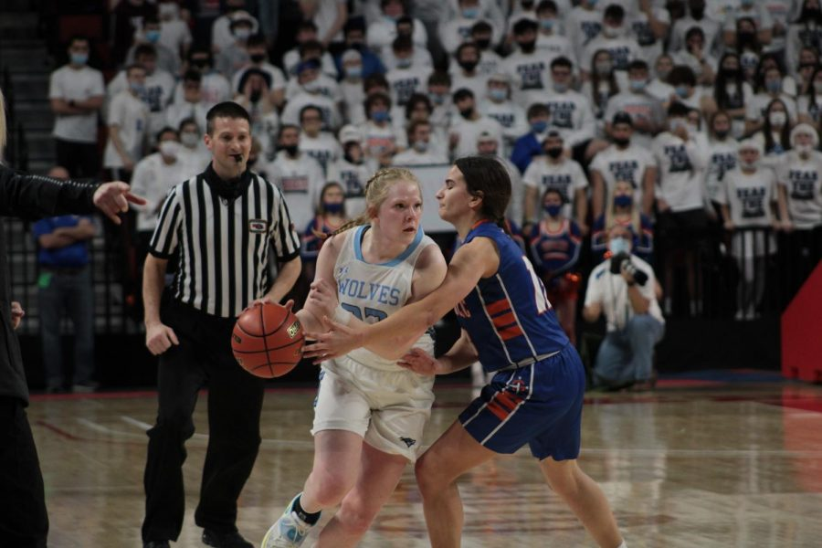 Reilly Palmer protects ball from opposing team.