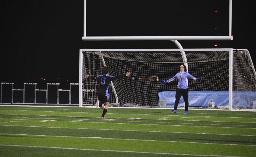 Landon Kennington (13), 11, and Parker Mahloch (0), 11, celebrating after winning the game. Photo by: Tara Binte Sharil