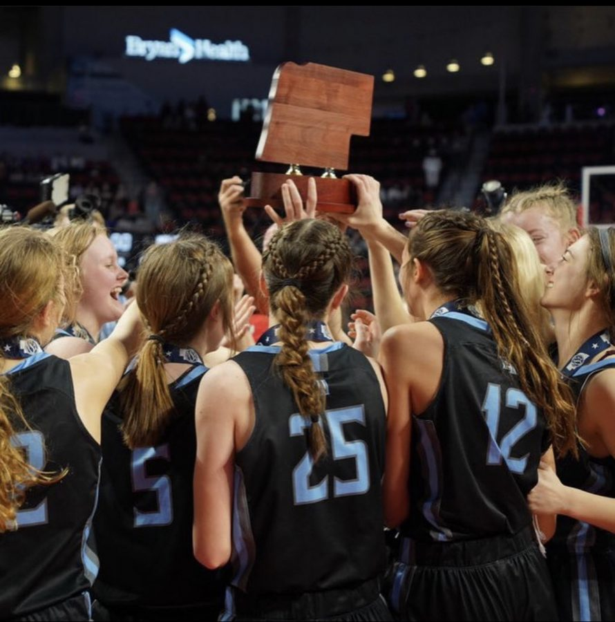 Junior, Molly Bruggeman, celebrates with her teammates after winning state.