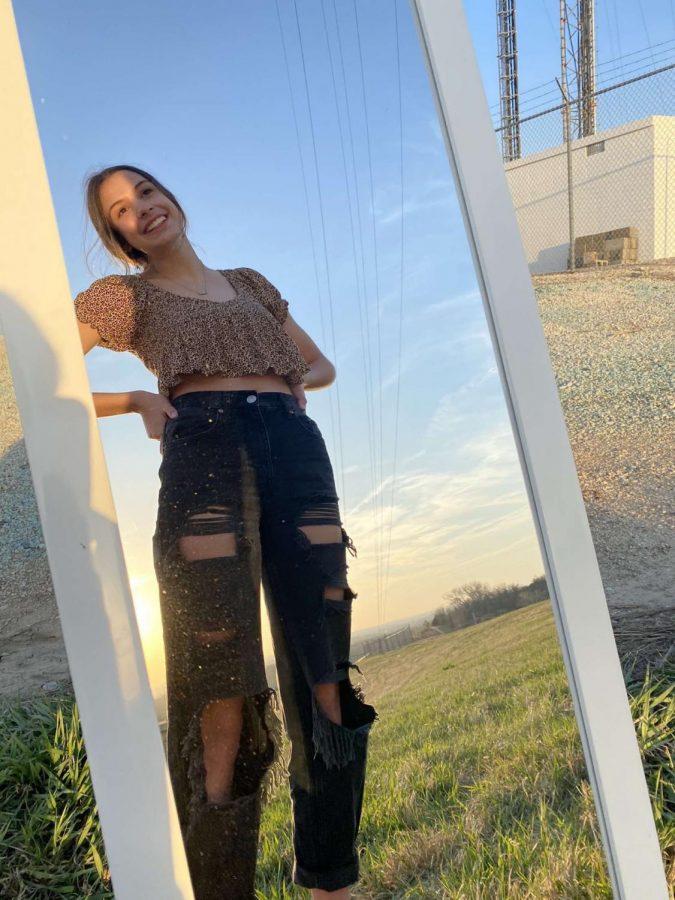 Kendall Backora rocking black mom jeans.