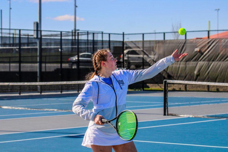 Paige Willcoxon, 11, serving the ball.