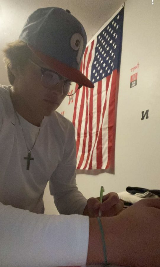 Drew Broady studying in his room for finals.
