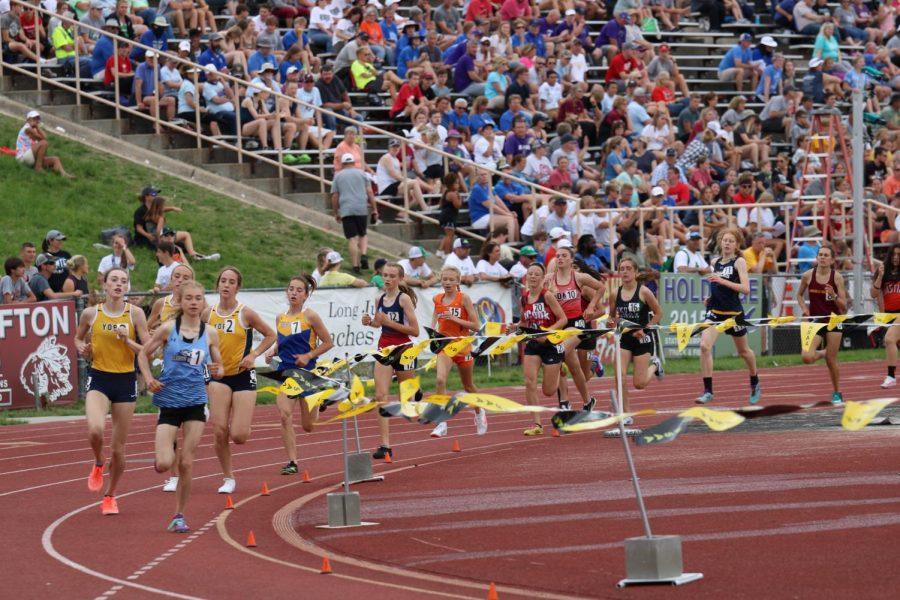 Julia Karmazin running the mile.