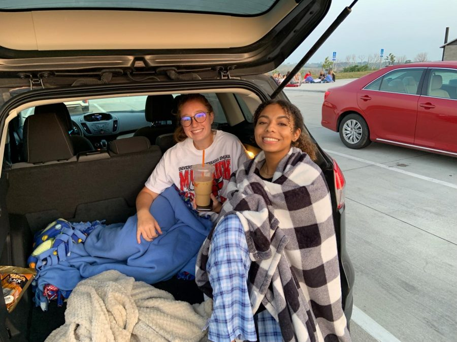 Paige Wilcoxon and Dalia Khallafalla sitting together at the Senior Sunrise.
