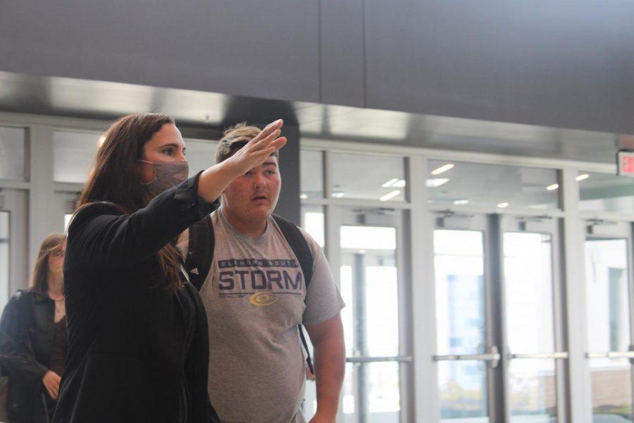 Dr. Christensen helping a student finding his next class.