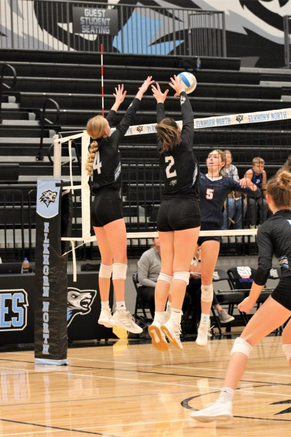Kailey Hrbek and Shay Heaney blocking a spike from the other team.