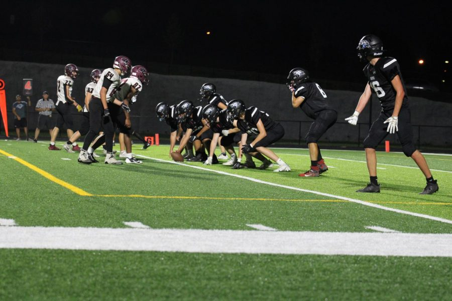 Wolves freshman team line up before a play.