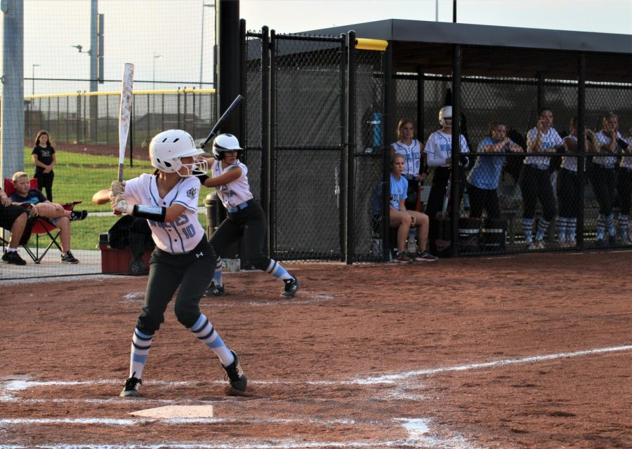 Paige White in a batting stance.