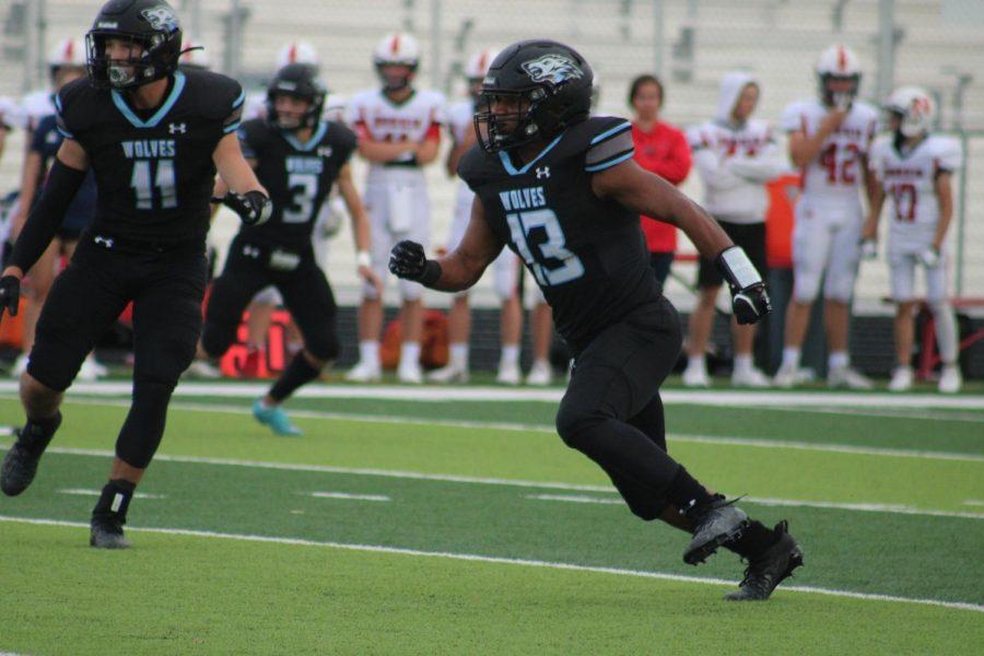 Senior Khalis Edwards runs to the ball.