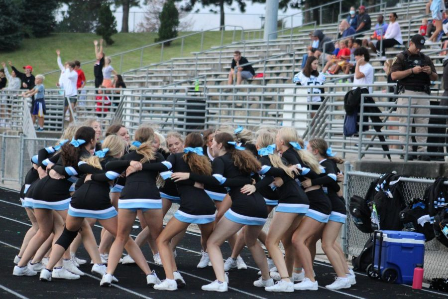 Cheerleaders get pumped up for the second half of the game.