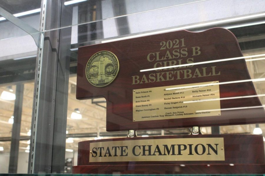 The girls basketball state championship trophy in the trophy case.