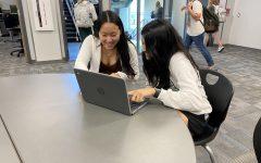 Sahasra Gollapudi and Annie Wang researching their debate topic.