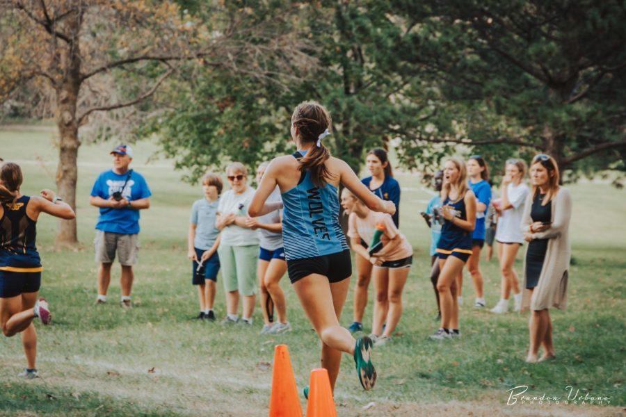 Meghan Cunningham running down a hill.