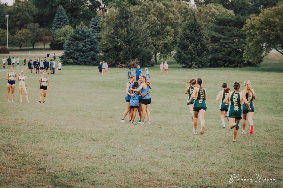Varsity girls huddling before their race.