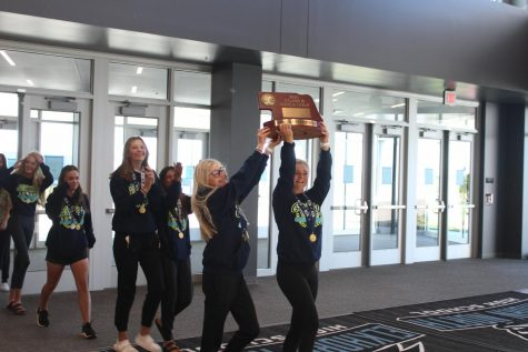 Photo Series: Girls Golf Brings Home the Trophy