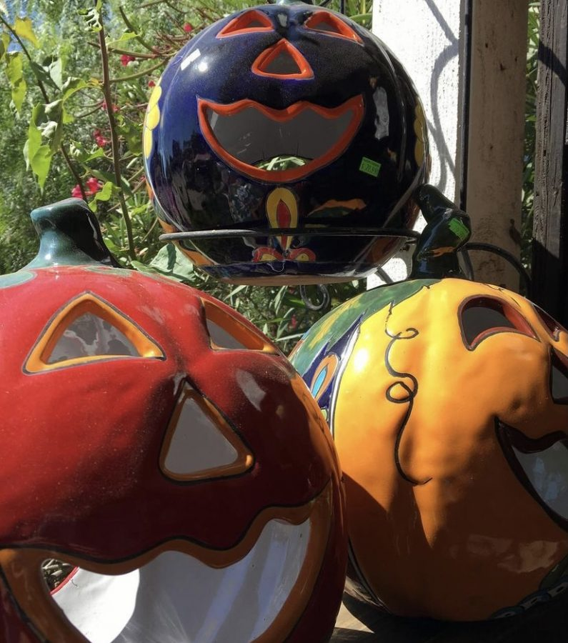 One way artisans captivate non-celebrators of the holiday is by painting pumpkins similarly to the way they paint their intricate skulls.