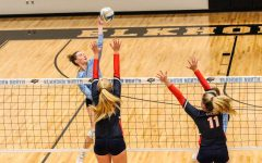 Grace Heaney spiking the ball while jumping midair.