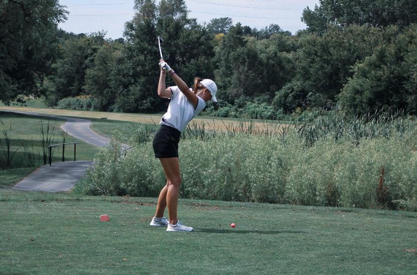 Emily Huff swinging her club.