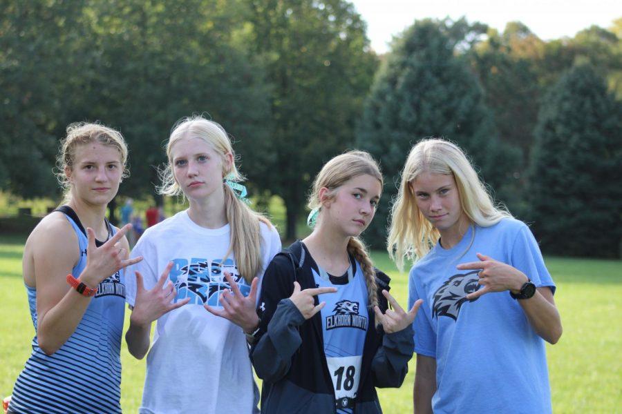 Varsity runners Sydeny, Kailey, Ella, and Britt bonding post race.
