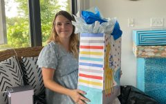 Chloe Healy holding a present at her baby shower